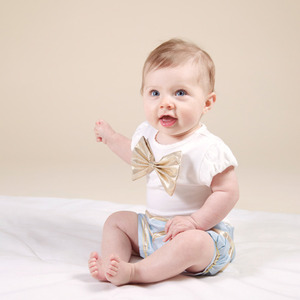 Gold Bow Onesie